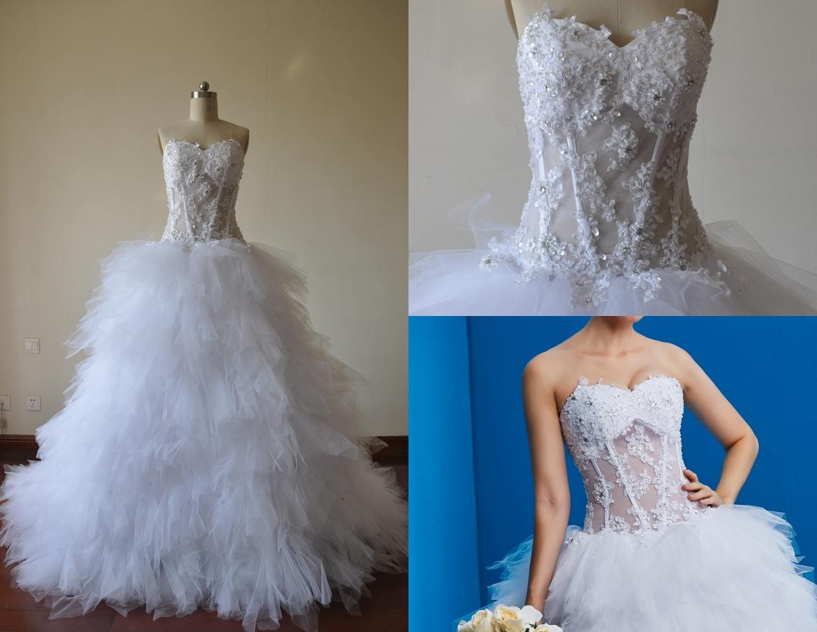 robe de mariée sexy bustier coeur en dentelle orné de strass taille avec jeu de transparence et jupe à volant