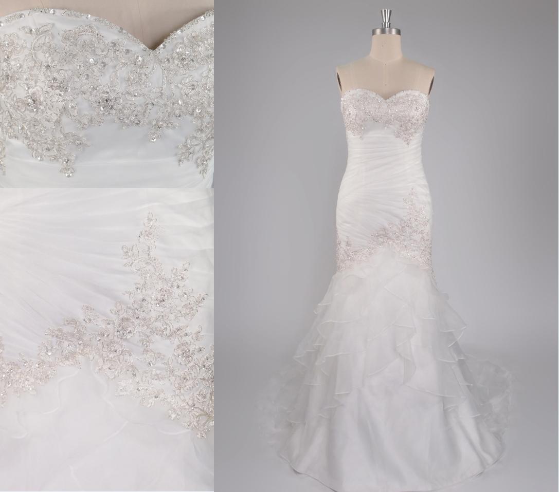 robe de mariée sirène bustier coeur ornée de guipure et de bijoux