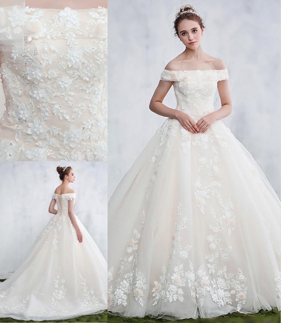 robe de mariée princesse épaule ouvert en dentelle appliquée florale